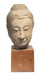 A THAI SANDSTONE HEAD OF BUDDH
