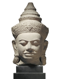 A KHMER-STYLE SANDSTONE HEAD O