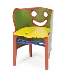 A RESIN CHILD'S CHAIR,