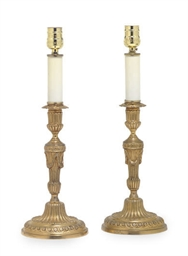 A PAIR OF GILT-BRONZE CANDLEST