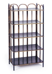 AN EBONIZED AND RATTAN ETAGERE