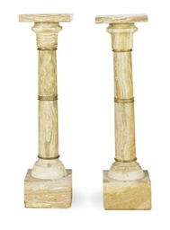 A NEAR PAIR OF ONYX PEDESTALS
