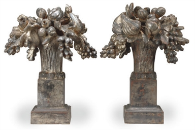 A PAIR OF SILVERED AND CARVED