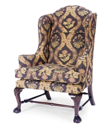 A MAHOGANY AND UPHOLSTERED WIN