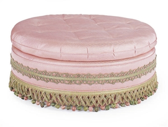 A PINK UPHOLSTERED POUF,