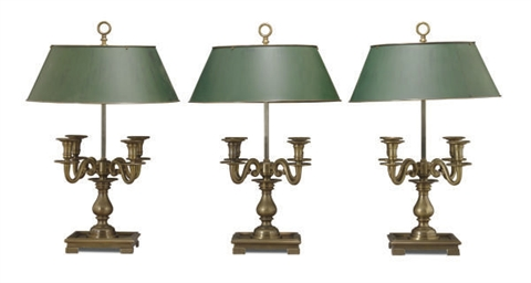 A SET OF THREE BRONZE TABLE LA