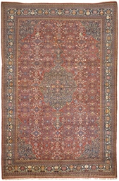 A LARGE FEREGHAN SAROUK CARPET