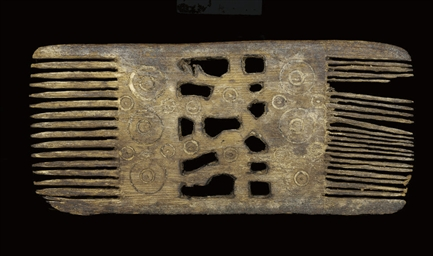A WOODEN COMB WITH PIERCED DEC