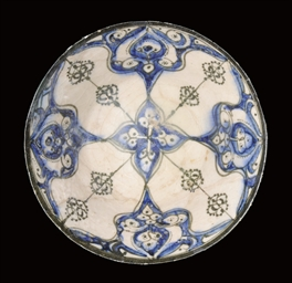 A KASHAN SILHOUETTE WARE BOWL,