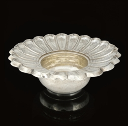 A FLUTED SILVER INCISED BASIN,