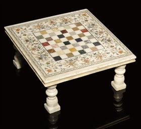 A WHITE MARBLE GAMES TABLE WIT