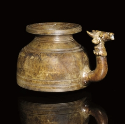 A BRONZE LOTA WITH BULL HEAD S