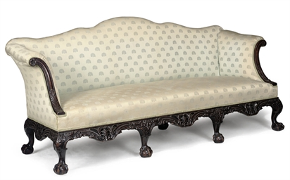 A CARVED MAHOGANY SOFA