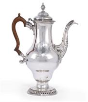 A LARGE GEORGE III SILVER COFFEE POT