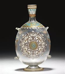 AN ENAMELLED CLEAR GLASS BOTTL