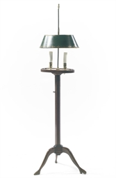 AN ENGLISH MAHOGANY FLOOR LAMP