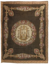 AN EMPIRE SAVONNERIE CARPET