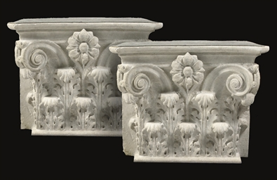 A PAIR OF CARVED SANDSTONE COM