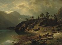 Figures near a mountain lake