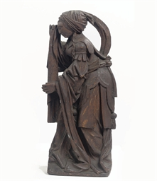 A CARVED OAK FIGURE OF MARY MA
