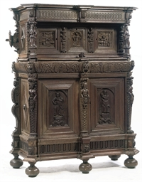 A FLEMISH CARVED OAK CUPBOARD
