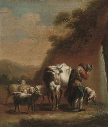 A herdsman with his cattle at