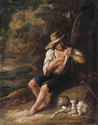 A shepherd with his dog
