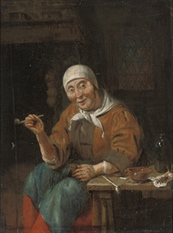 An old woman seated at a table