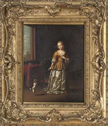 An elegant lady with a spaniel