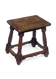A FRENCH WALNUT STOOL