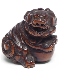 A JAPANESE WOOD NETSUKE