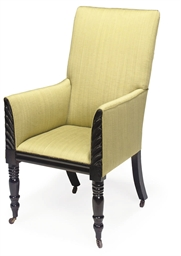 AN EBONISED AND UPHOLSTERED AR