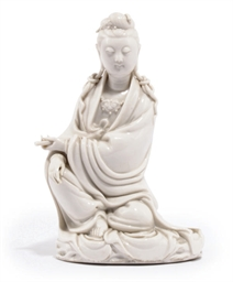 A CHINESE BLANC-DE-CHINE FIGUR