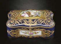 A GILT-METAL MOUNTED SEVRES STYLE COBALT-BLUE GROUND BOX AND COVER