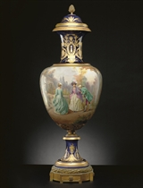 A LARGE ORMOLU-MOUNTED SEVRES STYLE COBALT-BLUE GROUND VASE AND COVER, 'LA RECONTRE'