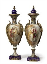 A PAIR OF ORMOLU AND CHAMPLEVE MOUNTED SEVRES STYLE COBALT-BLUE GROUND VASES AND COVERS