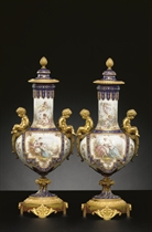 A PAIR OF ORMOLU-MOUNTED 'JEWELED' IVORY AND COBALT-BLUE GROUND VASES AND COVERS