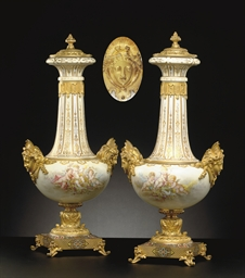 A PAIR OF CHAMPLEVE AND ORMOLU