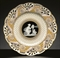 A MINTONS PATE-SUR-PATE IVORY-GROUND RETICULATED PLATE