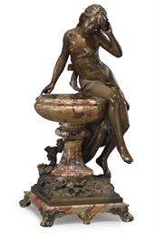 A FRENCH PATINATED BRONZE AND