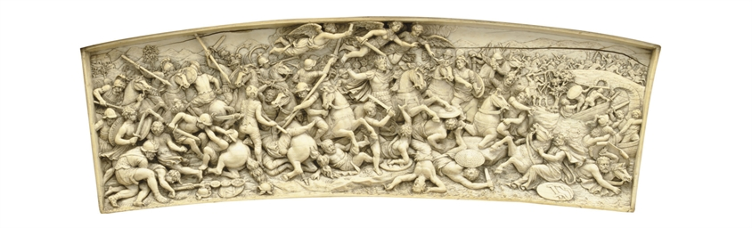 A GERMAN CARVED IVORY RELIEF P