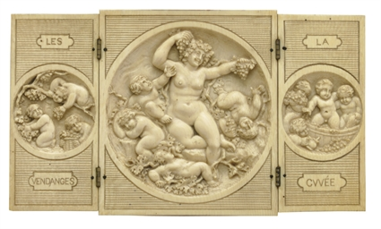 A CONTINENTAL CARVED IVORY TRI