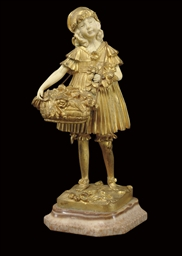 A GILT-BRONZE AND IVORY FIGURE