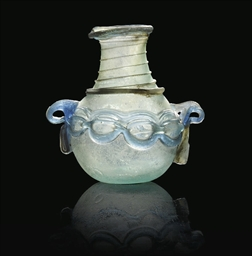 A ROMAN BLUE BLOWN GLASS FLASK