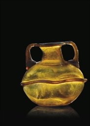 A ROMAN BROWN BLOWN GLASS FLAS