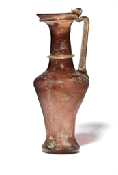 A ROMAN AUBERGINE BLOWN GLASS
