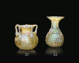 A ROMAN AMBER BLOWN GLASS JAR