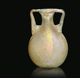 A ROMAN PALE BLUE BLOWN GLASS