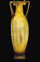 A ROMAN AMBER BLOWN GLASS FLAS