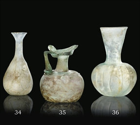 A ROMAN BLOWN CLEAR GLASS FLAS